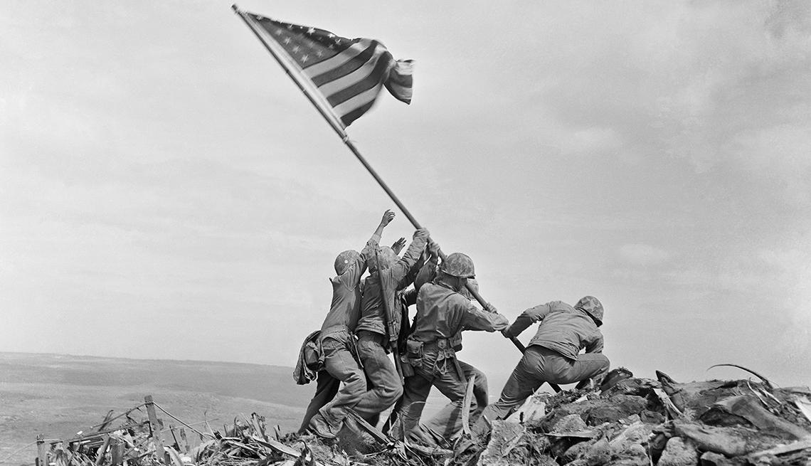 Marines raising an American flag during the battle of Iwo Jima