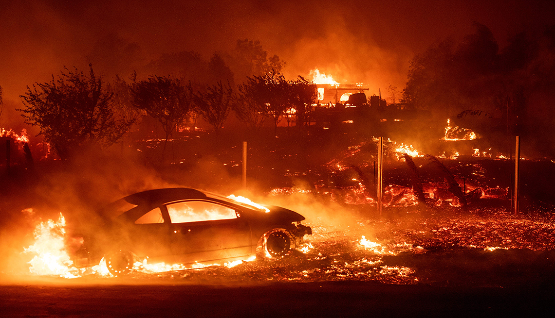item 3 of Gallery image - vehicles and homes encased in flames burning on november 8 2018 during the camp fire in paradise ca