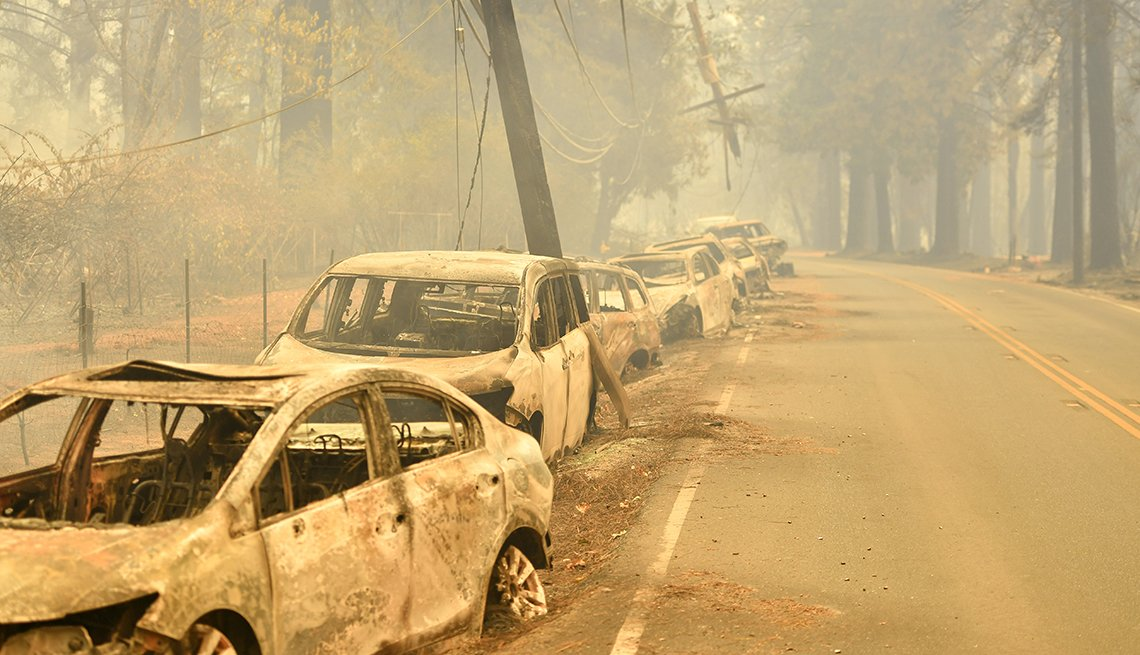 A row of abandon cars line the road after a wildfire