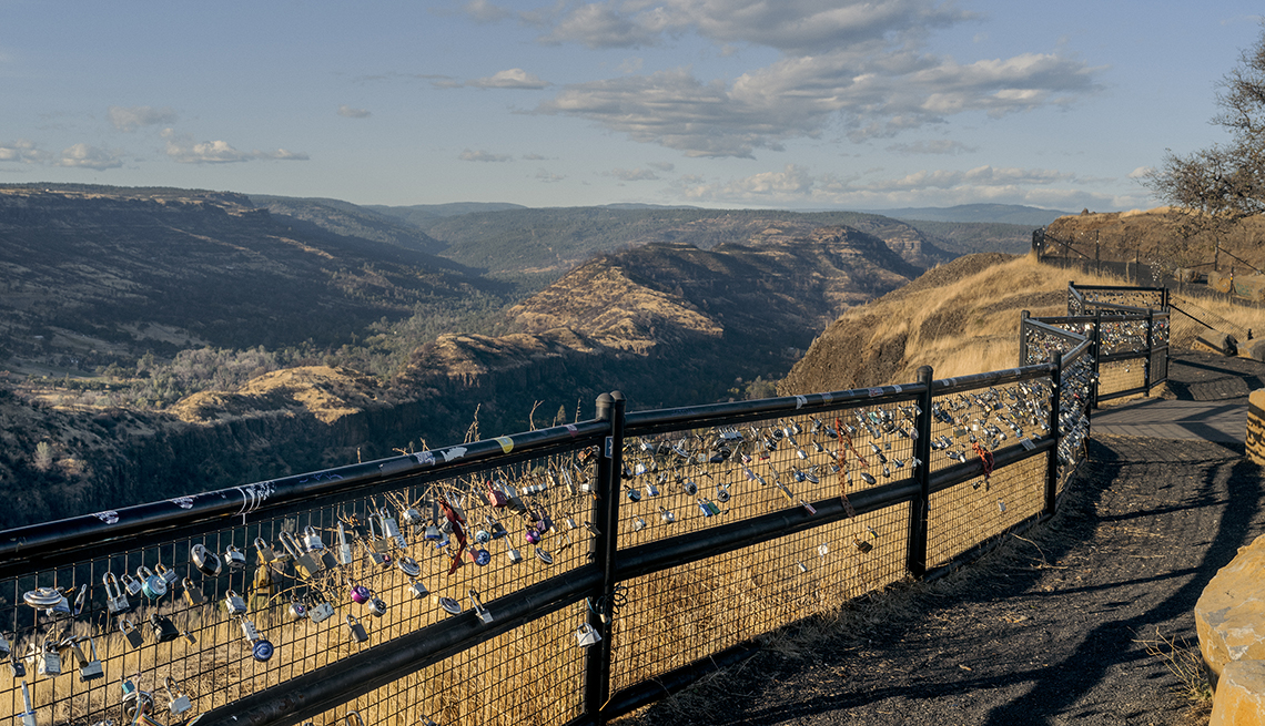 item 7 of Gallery image - Dozens of combination locks hang from a fence at the scenic butte creek canyon overlook