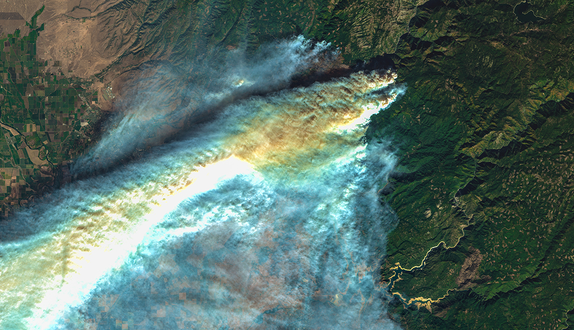 item 2 of Gallery image -  an enhanced satellite image of huge plumes of smoke over paradise california showing the Camp Fire in progress from  November 11 2018