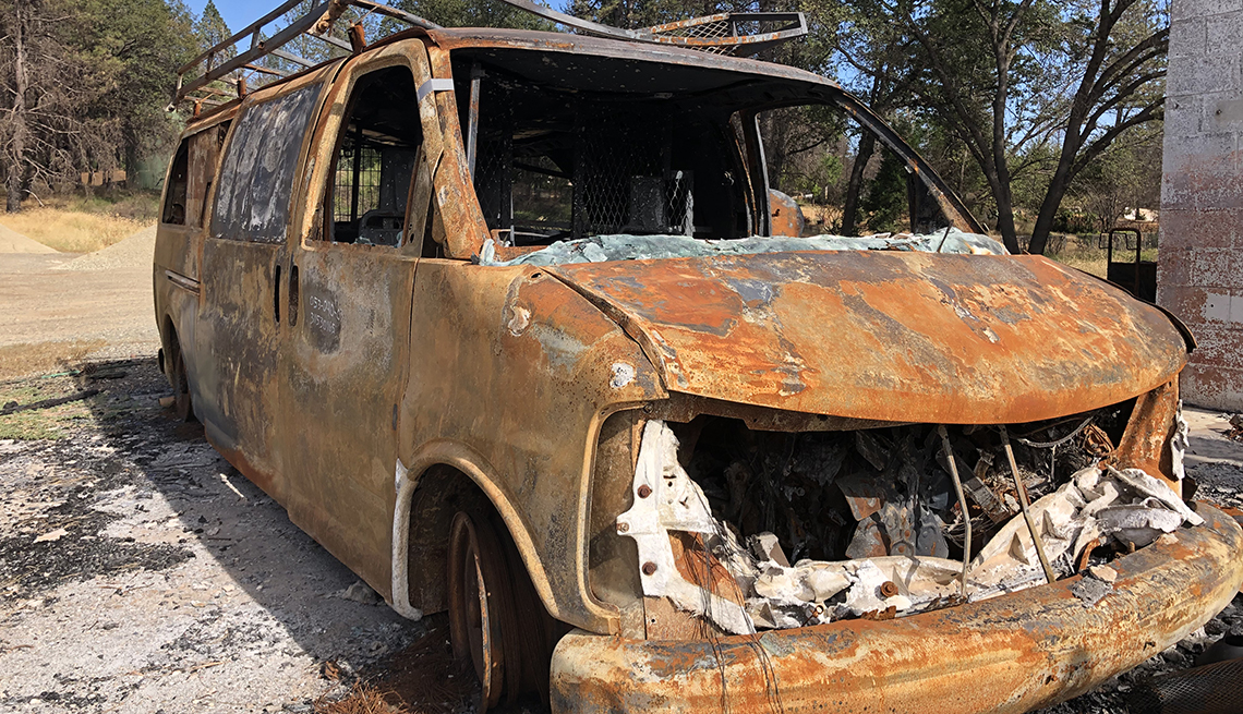 item 6 of Gallery image - the charred remains of a van that is missing its front grill, tires, and windows