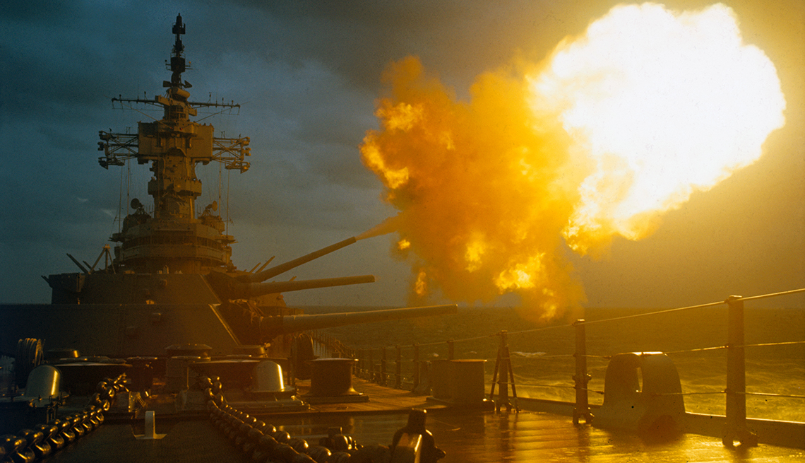 A battleship fires its guns