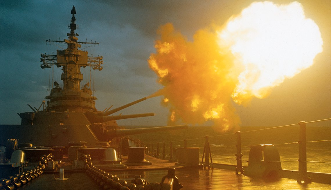 A battleship fires its guns