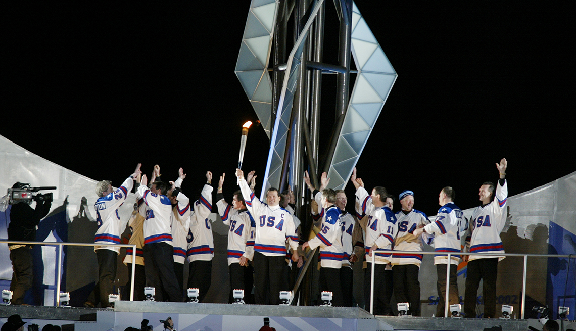 item 5 of Gallery image - Members of the miracle on ice hockey team light the torch at the Salt Lake City Winter Olympics