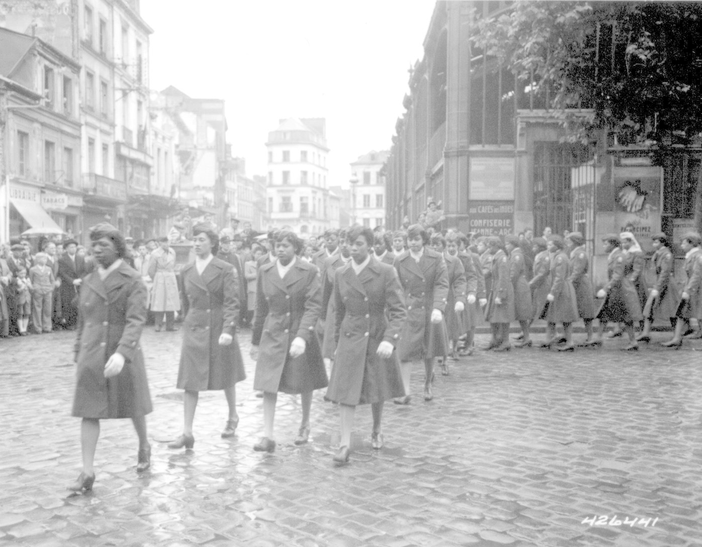 A unit of African American women march during World War Two