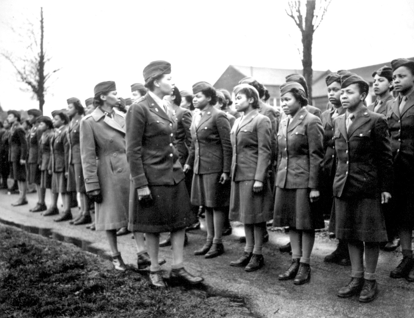 A unit of African American women are being inspected by instructors during World War Two
