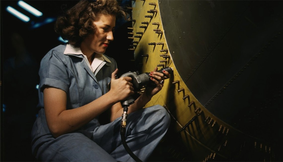A riveter at work on a Consolidated bomber in October 1942 at Consolidated Aircraft Corp. in Fort Worth, Texas.