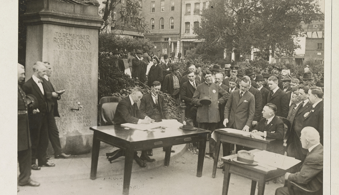item 8 of Gallery image - historical photo of court proceedings being held outdoors in san francicso during influenza outbreak