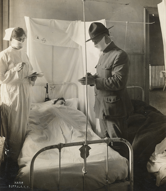 item 4 of Gallery image - influenza patient in a hospital bed flanked by military officer and nurse who are both wearing masks