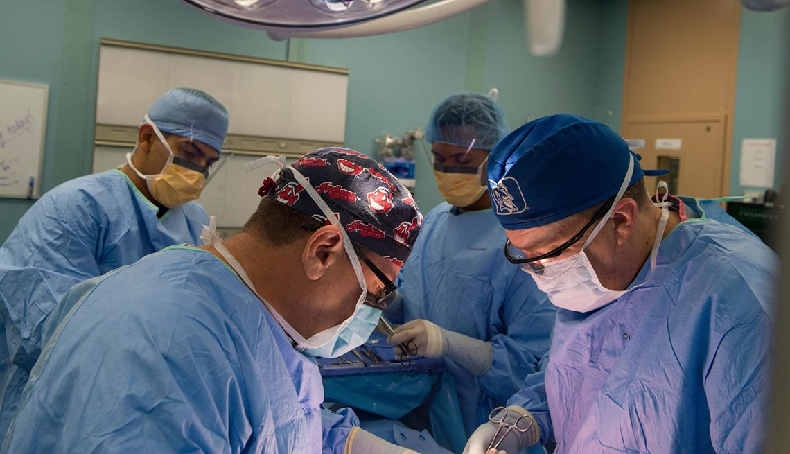 item 5 of Gallery image - Four doctors are working during a surgery