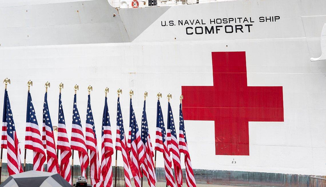 A red cross on the side of the U S N S Comfort