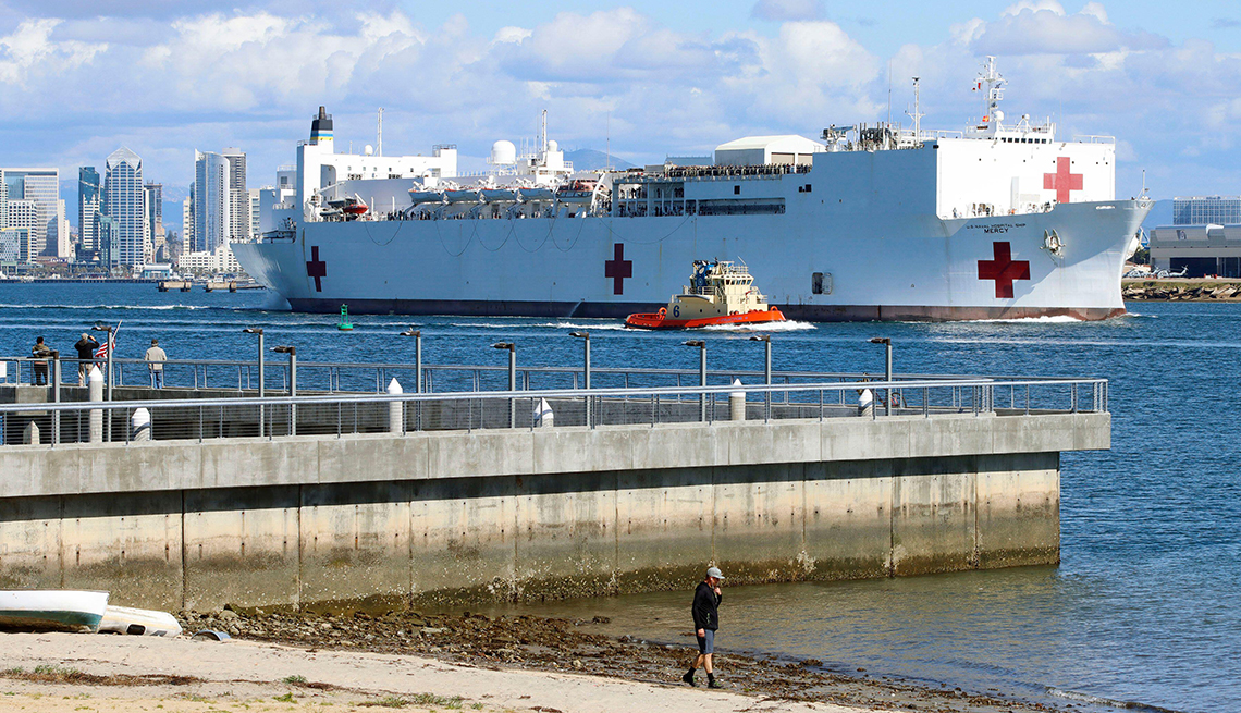 item 1 of Gallery image - large u s navy hospital ship is seen pulling out of a harbor accompanied by a tugboat