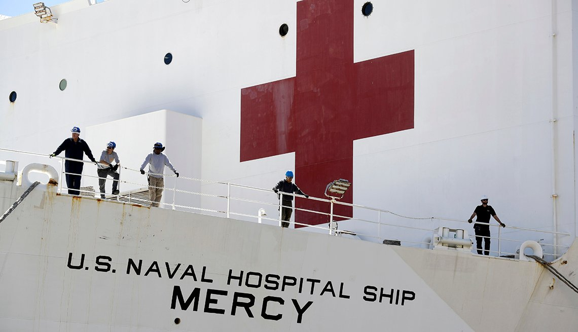 closeup of hospital ship with the identifier name mercy showing on its side