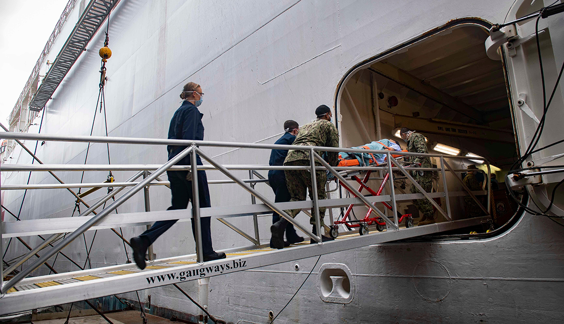 item 4 of Gallery image - sailors bring a patient up a ship gangplank on a gurney