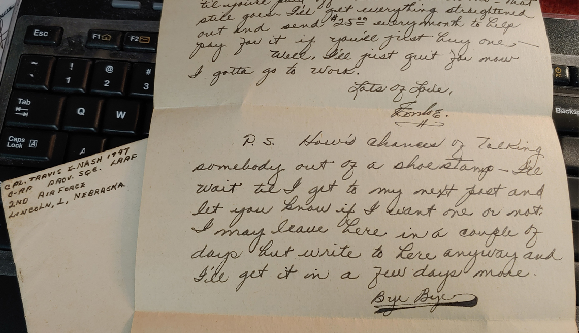 item 5 of Gallery image - picture of a handwritten world war two letter lying atop a computer keyboard