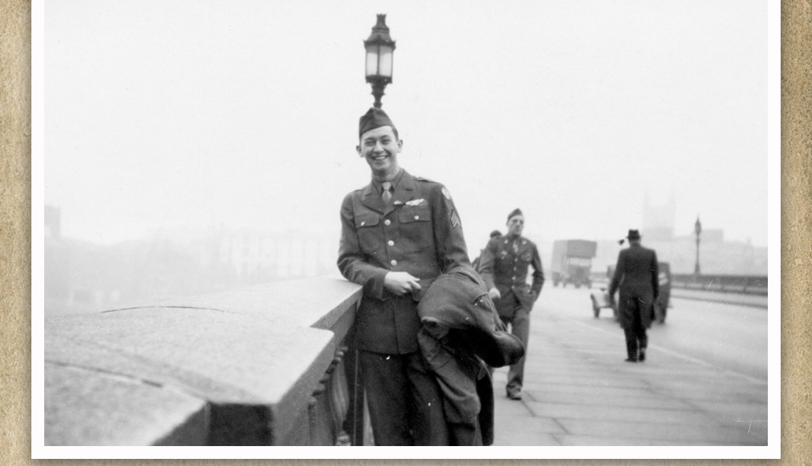 item 3 of Gallery image - a young american soldier stands on a bridge during a foggy day in london in this black and white photo from world war two