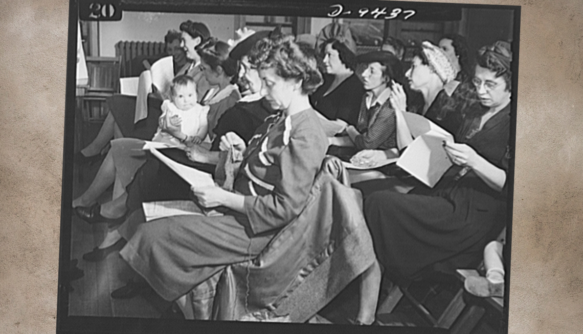 item 6 of Gallery image - two rows of women sitting in chairs holding informational papers and reading in a classroom setting