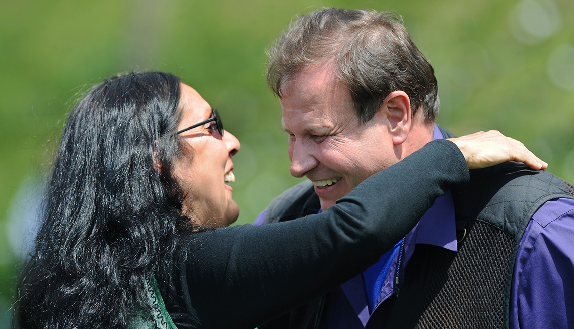 A man and woman hugging on the May fourth Kent State Shooting Anniversary