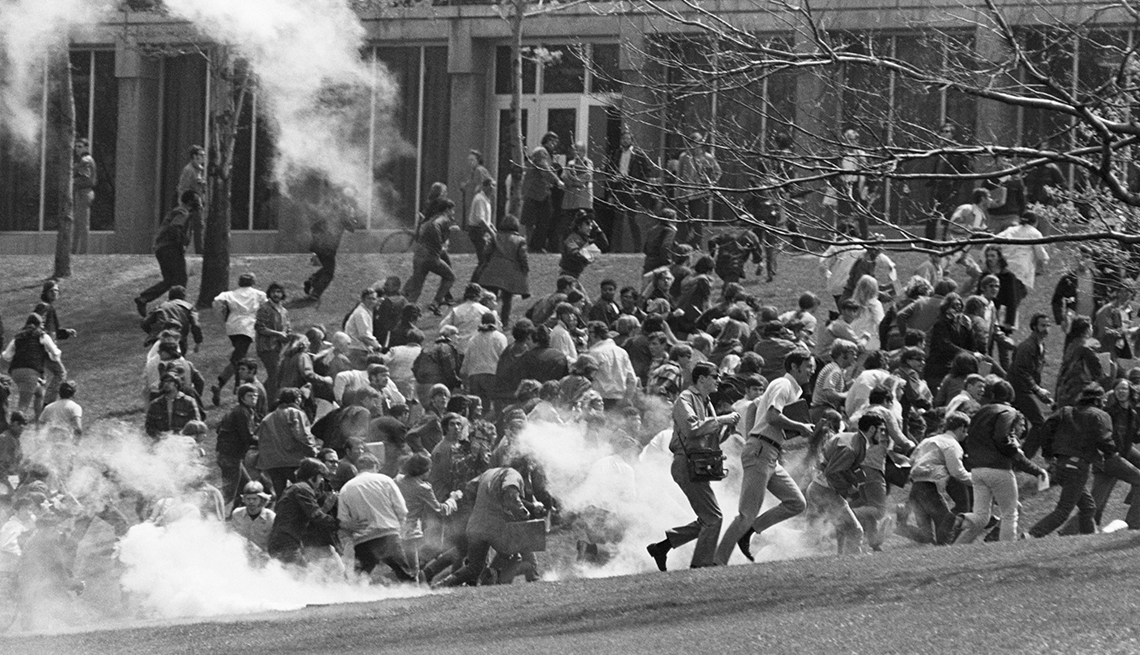 People running from tear gas at Kent State University