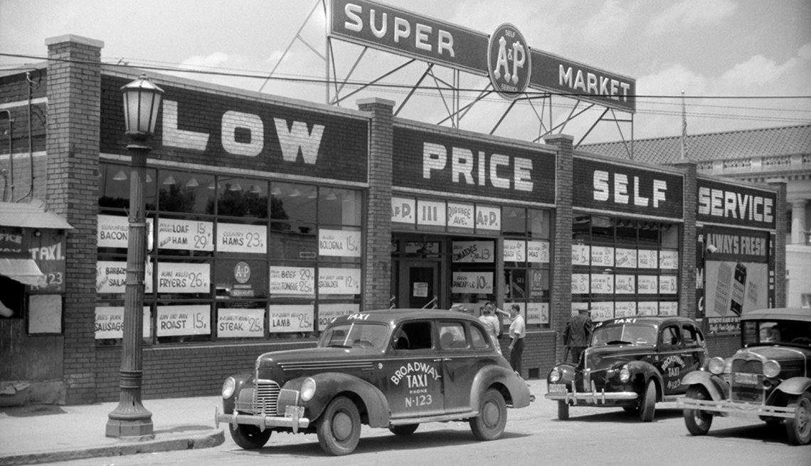 item 13 of Gallery image - black and white photo from the nineteen forties showing an a and p supermarket store front with cars parked in front