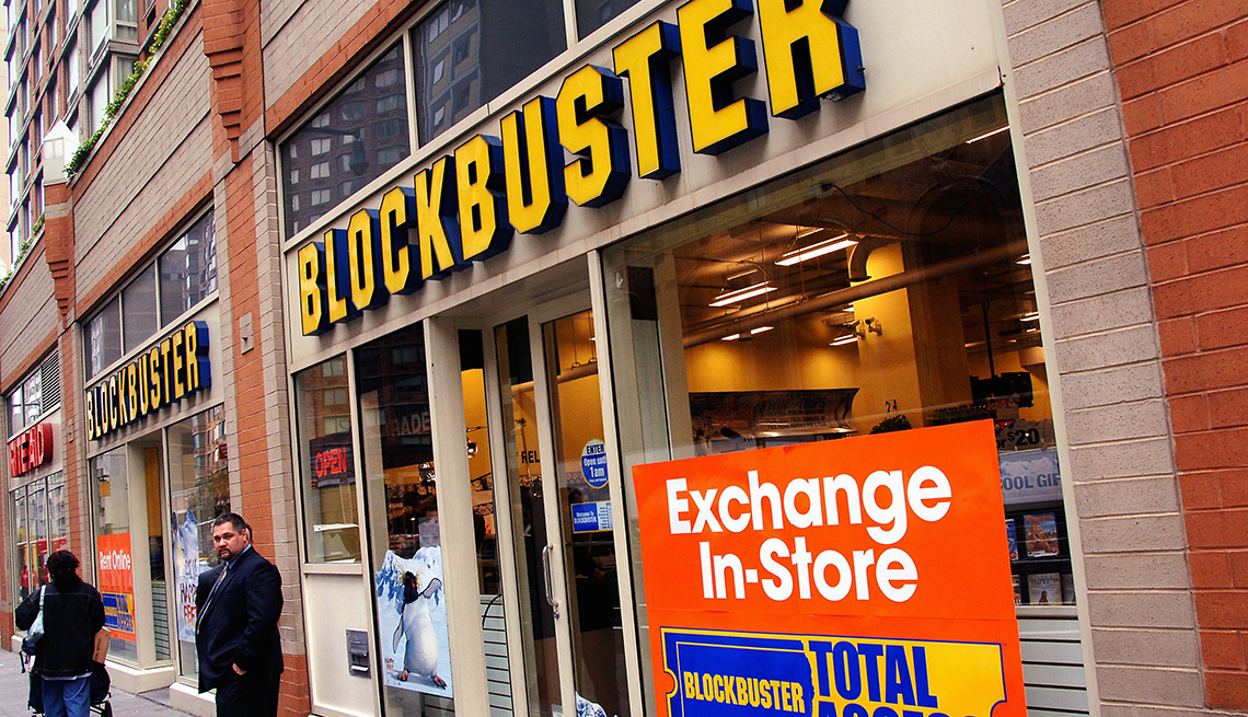 item 1 of Gallery image - outdoors store front view of a blockbuster video retail store