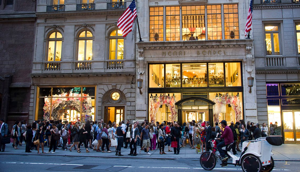 item 15 of Gallery image - evening street view of the front of a henri bendel retail store with shoppers lined up outside from two thousand eleven