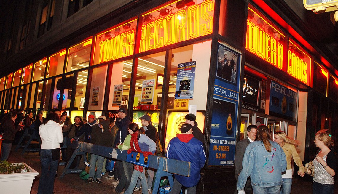 item 2 of Gallery image - photo from the year two thousand six of fans lining up outside a tower records store in a city at night