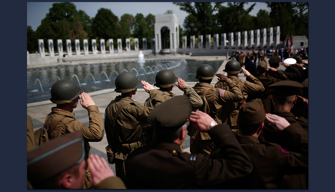 item 10 of Gallery image - group of soldiers salute at the world war two memorial in washington d c at a rememberance ceremony