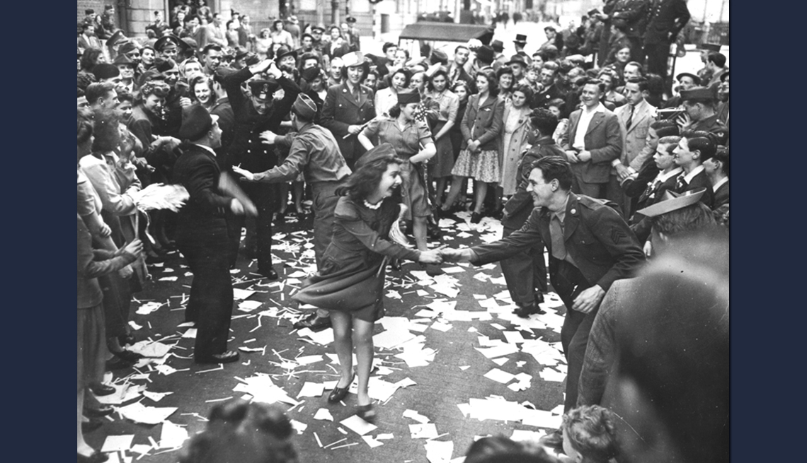 item 9 of Gallery image - people dancing joyously in the street during v e day celebrations in this black and white image