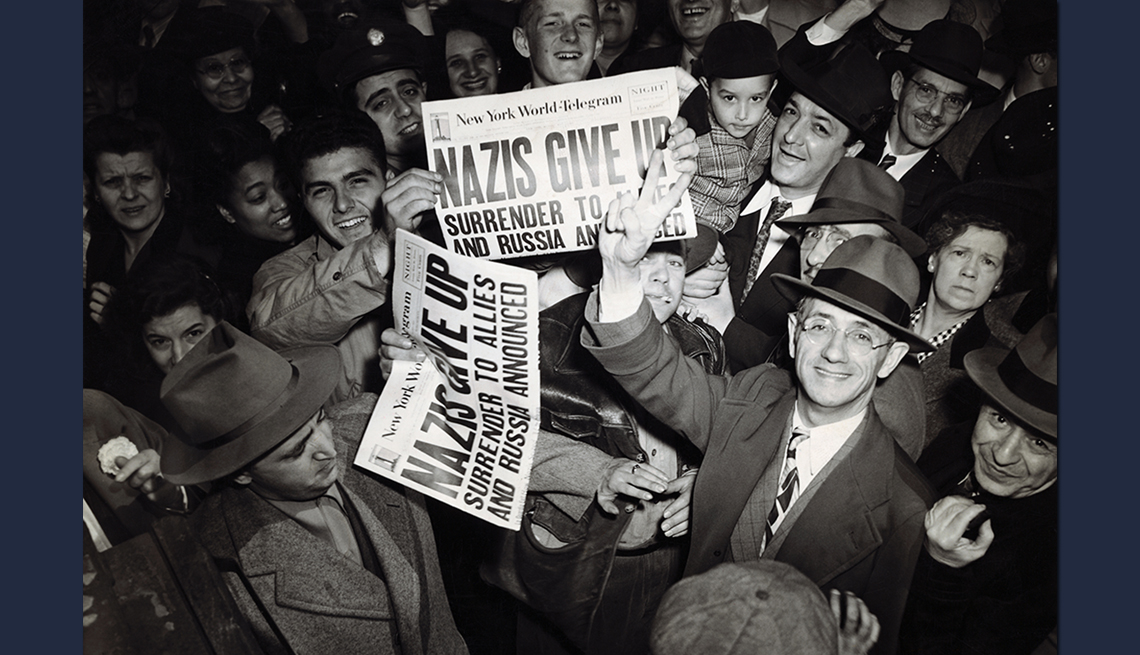 item 4 of Gallery image - crowd of people holding up newspapers proclaiming german surrender at the end of world war two