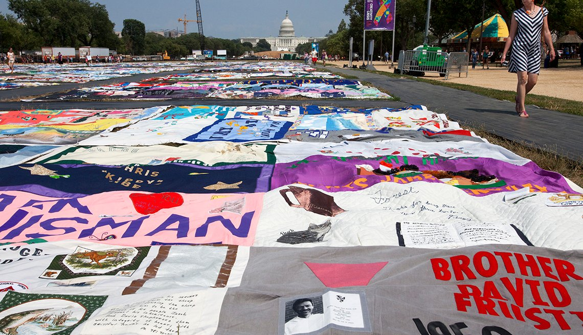 People visit the AIDS Memorial Quilt on display as part of the Smithsonian Folklife Festival on the National Mall in Washington, on Thursday, July 5, 2012. An AIDS-free generation: It seems an audacious goal, considering how the HIV epidemic still is ragi