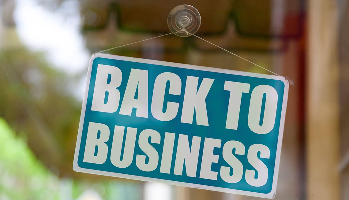item 4 of Gallery image - store window sign saying back to business