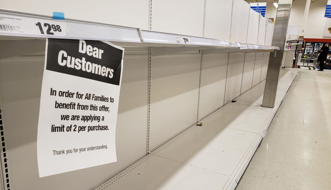 item 2 of Gallery image - empty shelves in a store with a sign imposing limits on purchases