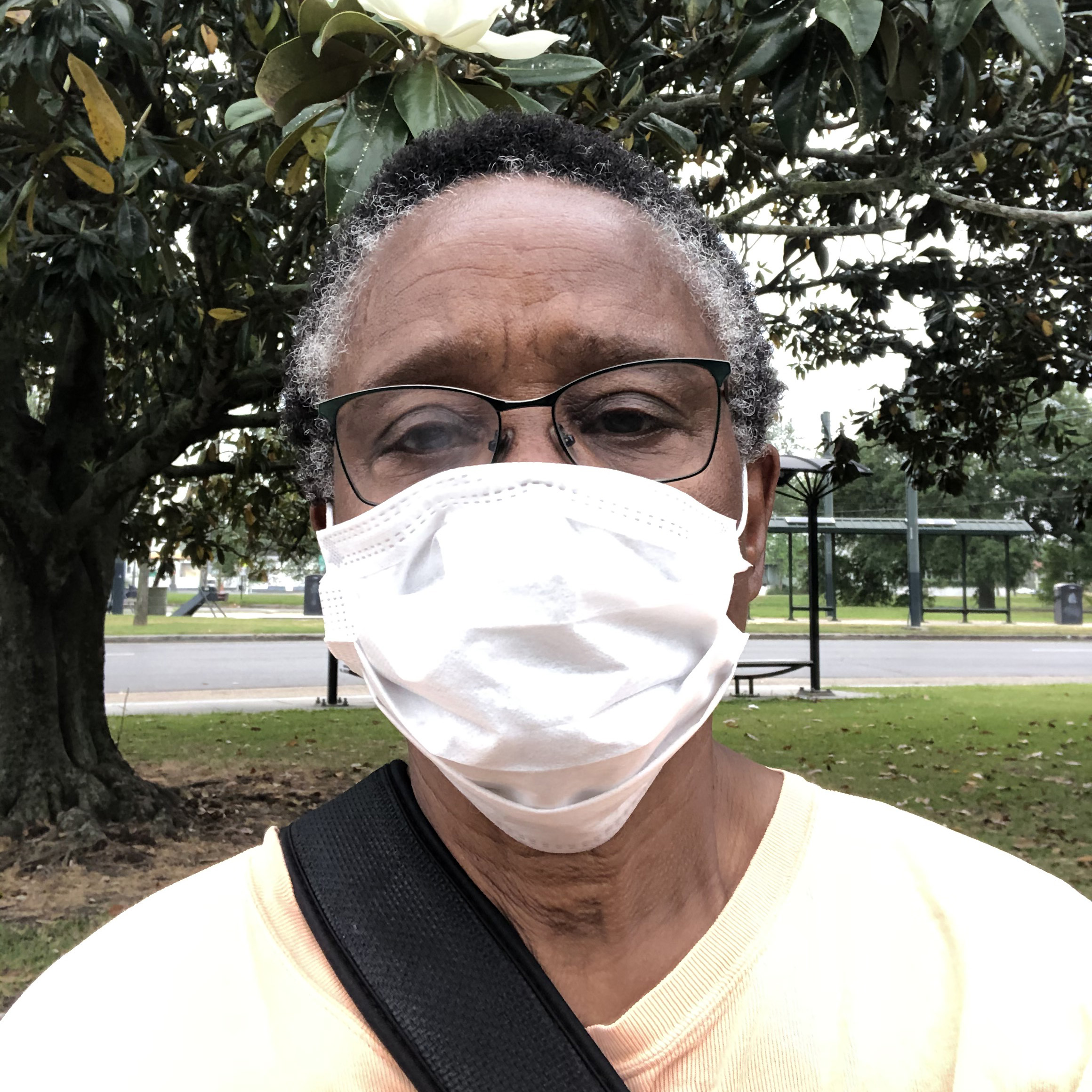 close up portrait of freddye hill wearing a covid face mask outdoors in a park