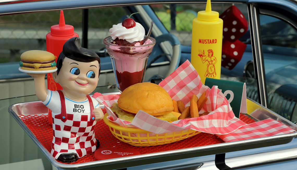 item 6 of Gallery image - dining tray attached to a classic car window filled with a meal and a bobs big boy figurine