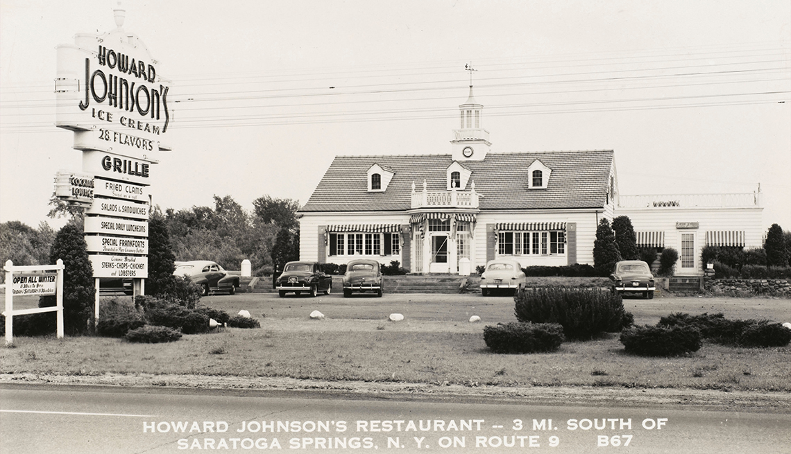 item 1 of Gallery image - black and white historical photo of a howard johnsons restaurant and its large sign in front