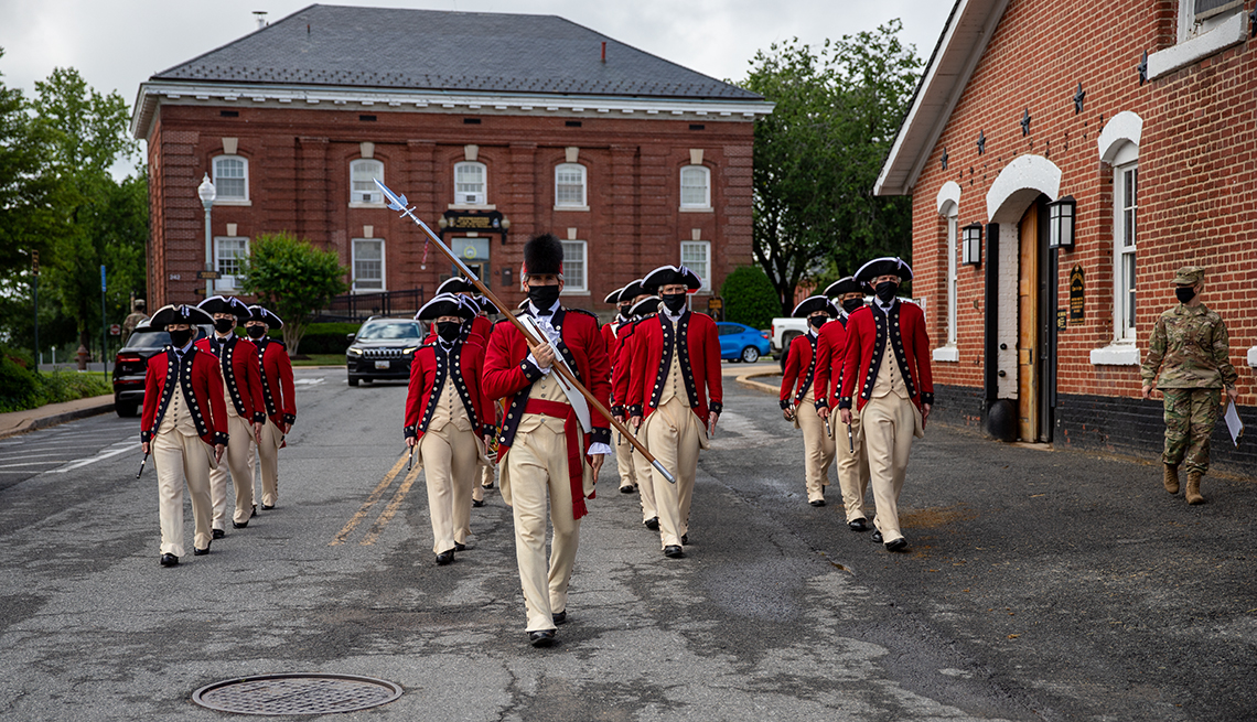 united states army soldiers in training practice in formation for the old guard fife and drum corps