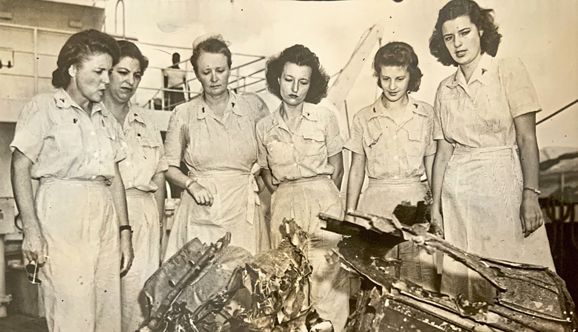 old sepia toned world war two photo of a group of six american nurses on board a navy ship