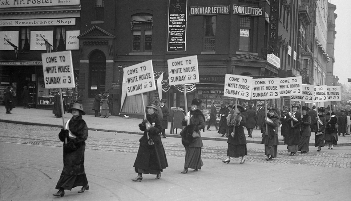 A line of women protesting the right to vote