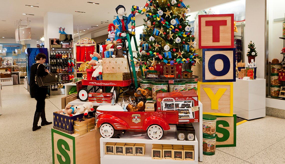 a christmas toy display in a department store that includes a decorated tree a fire engine and toys displayed