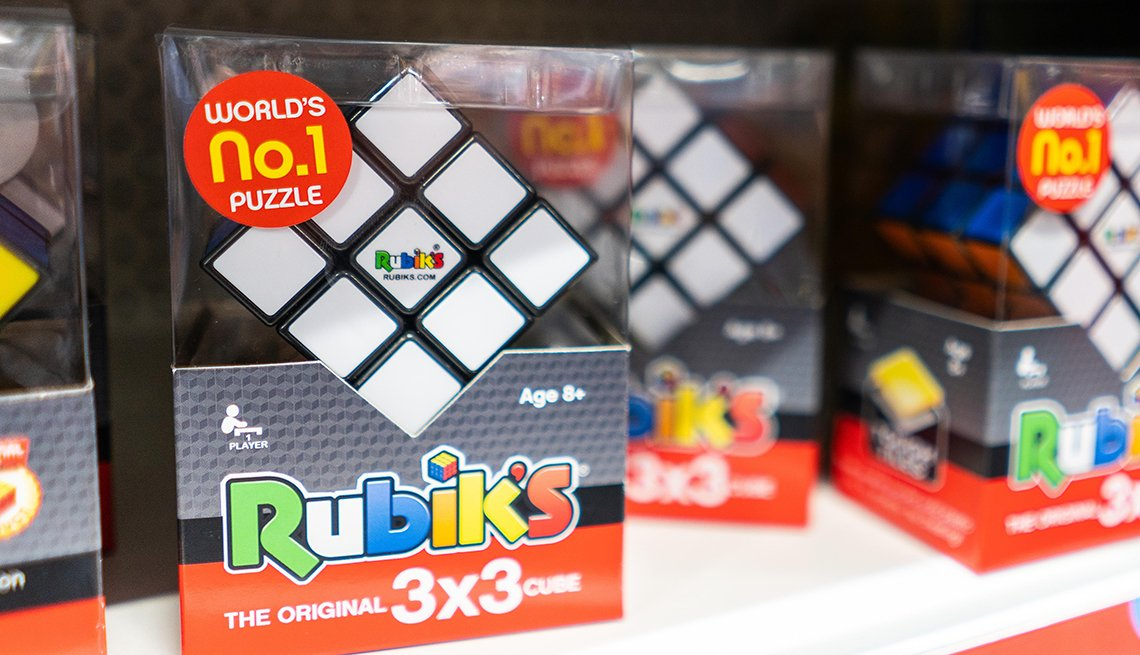 item 8 of Gallery image - a store shelf containing packages of rubiks cubes