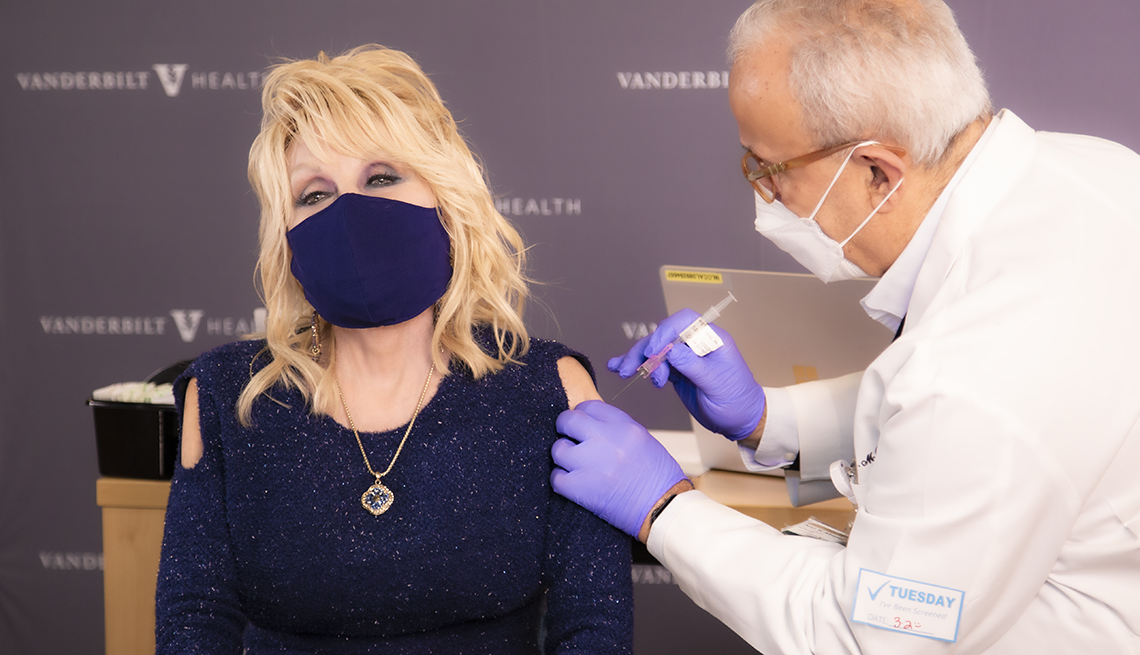 item 6 of Gallery image - dolly parton receives a covid vaccine shot