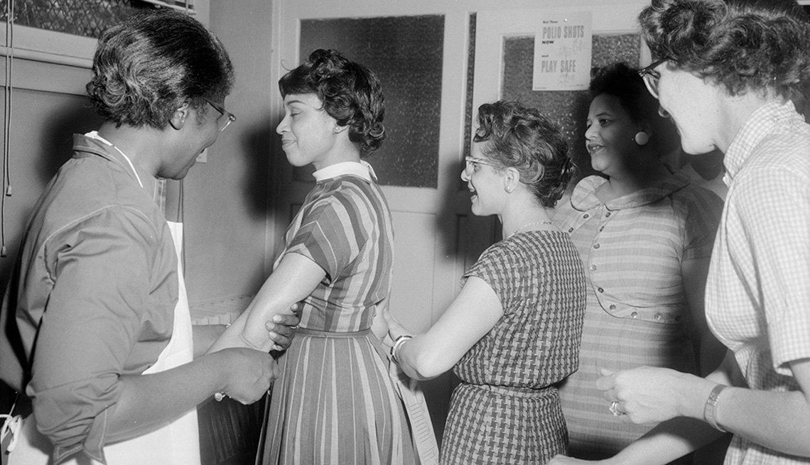 item 9 of Gallery image - young women in line for a polio vaccine in this image from the nineteen fifties
