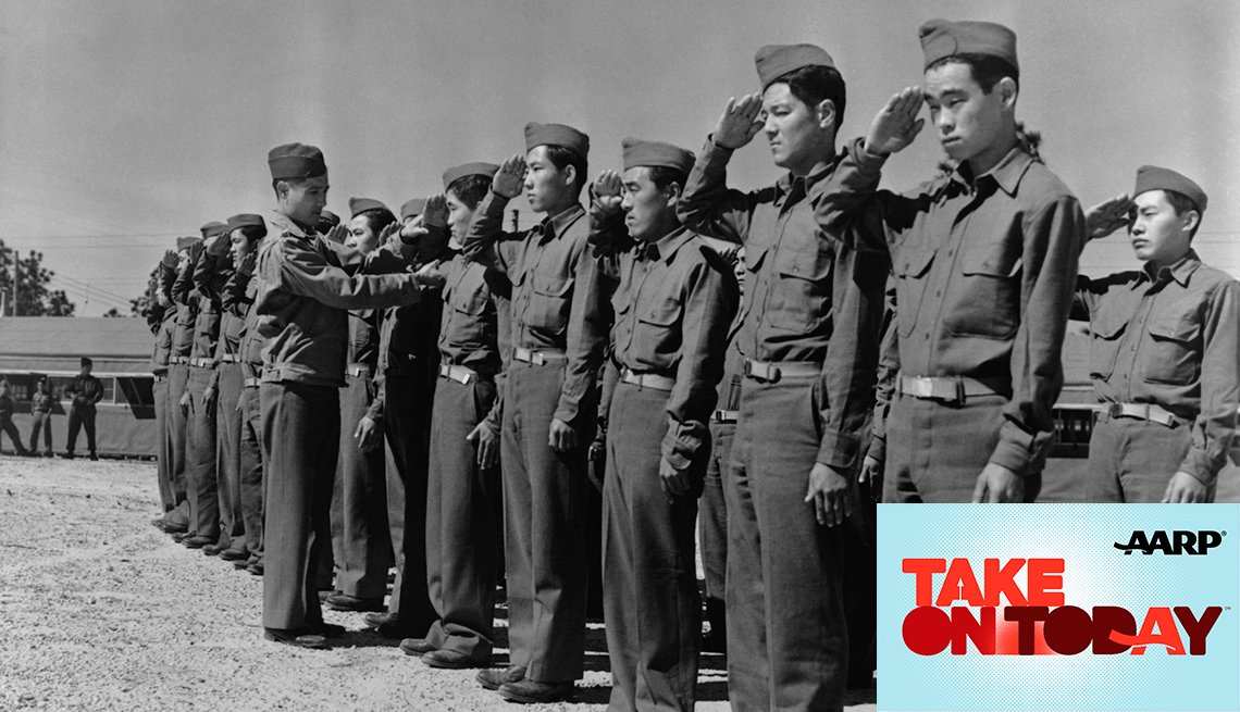 Soldiers standing in line saluting