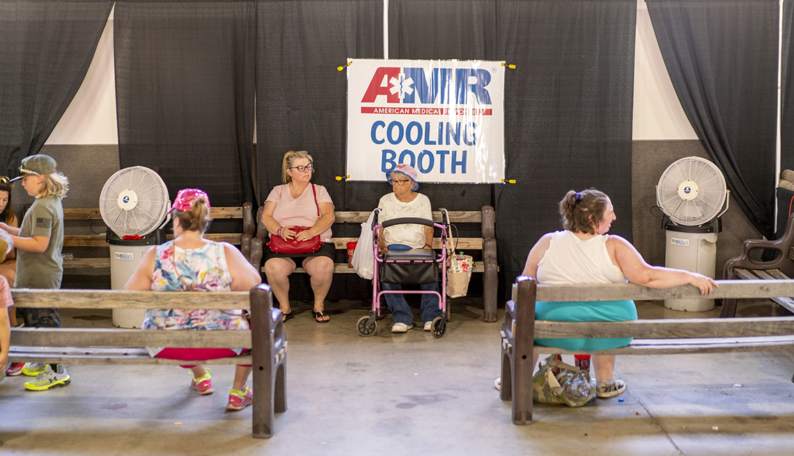 People sit at a cooling center