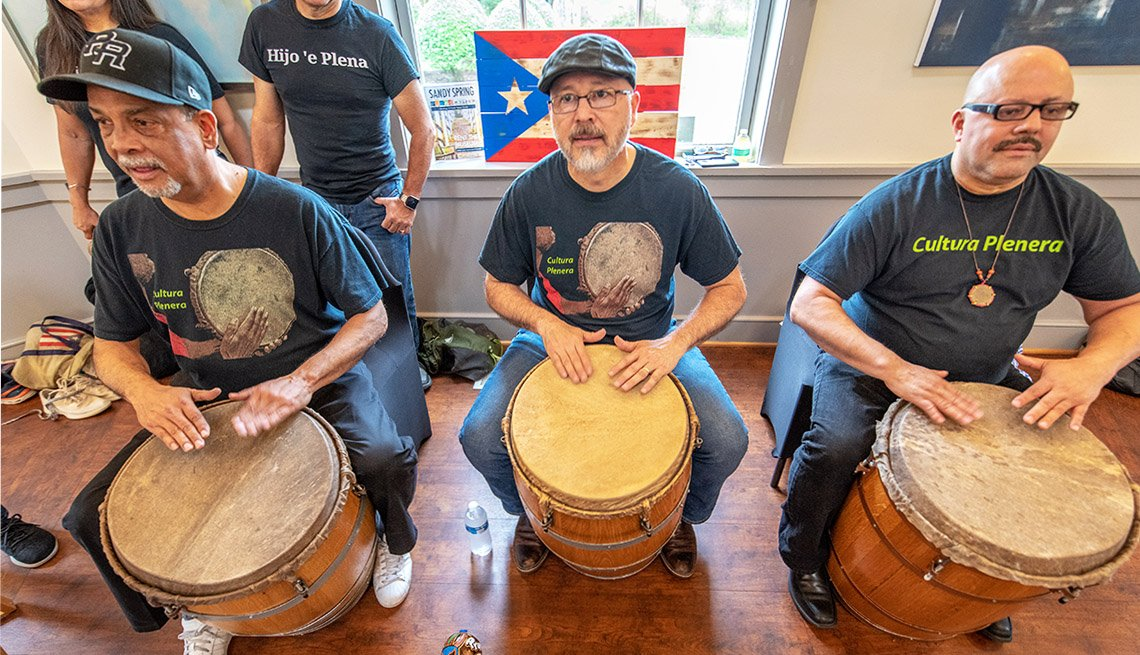 Three Maryland musicians play drums and sing to enjoy the music and dance of Cultura Planera, a Puerto Rican bomba y plena tradition