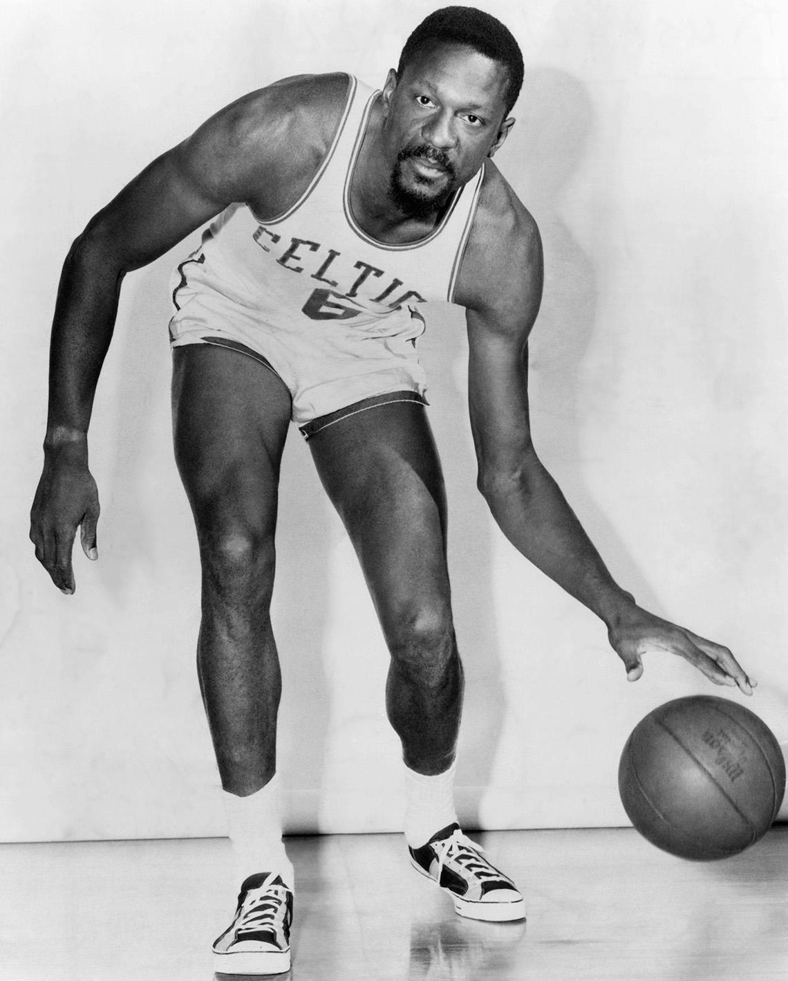 Boston Celtics basketball player Bill Russell dribbling a basketball