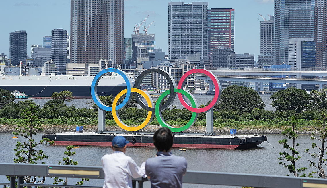 a large scale version of the five colorful olympic rings are displayed in tokyo bay for the games