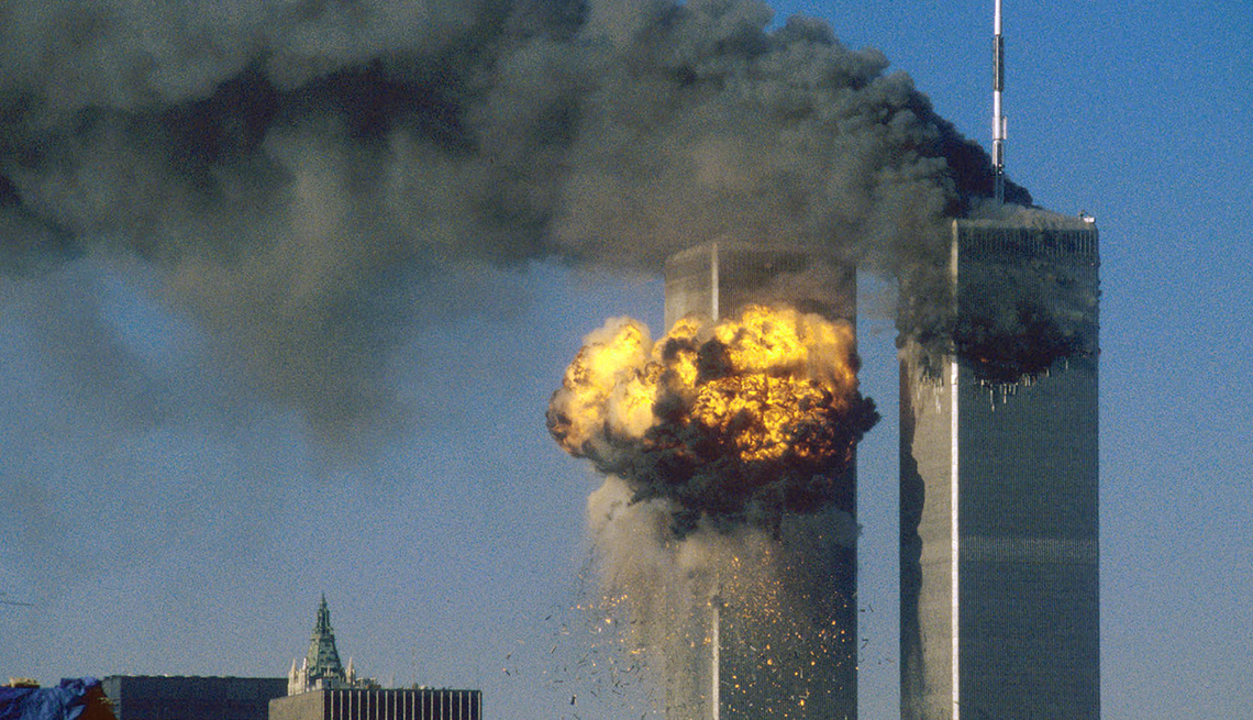 the attack on the world trade center show both towers struck and burning